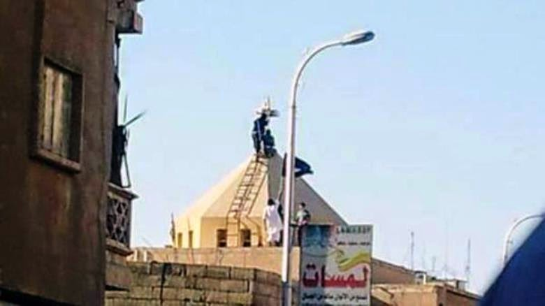 Cross being removed from the Armenian Church in Raqqa, Syria