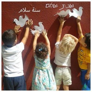 Jewish, Arab students post 'A Year in Peace' doves HAND IN HAND