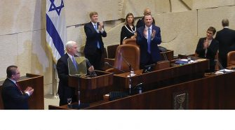 """US Vice President Mike Pence receives standing ovation from eight hundred guests in Israel's parliament, the Knesset, on January 22, 2018, when he declares, """"Jerusalem is Israel's capital."""""""