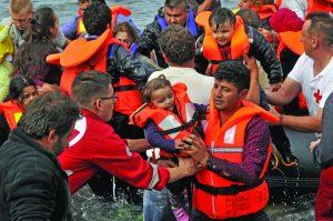 Syrian-refugees-landing-in-Greece.-Photo-via-www.shutterstock.com-